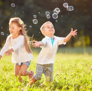 2 children in field with bubbles.png